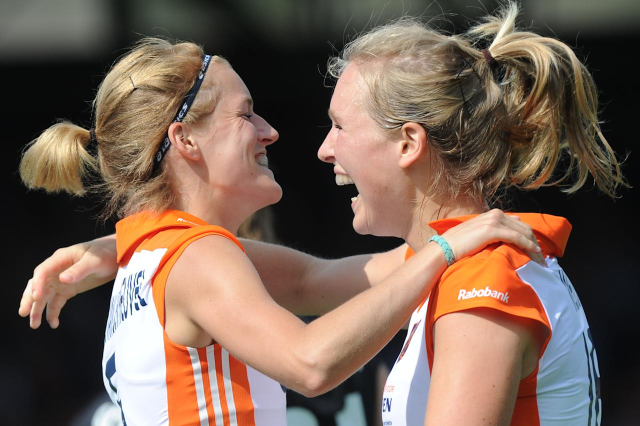 Carlien Dirkse van den Heuvel, left, of Netherlands celebrates with teammate Carlijn Welten after the first  goal against Germany during the women's Champions Trophy group B hockey match in Amsterdam, Netherlands, Sunday, June 26, 2011. (AP Photo/Ermindo Armino)
