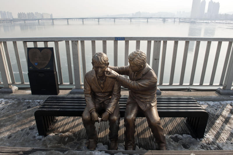 South Korea has erected statues and installed monitoring devices to dissuade potential suicides at Mapo Bridge over the Han river in Seoul