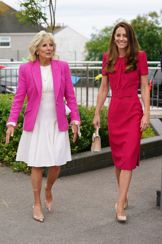 """<p>Kate chose a magenta belted Alexander McQueen dress and neutral pumps when she accompanied <a href=""""https://www.townandcountrymag.com/style/fashion-trends/g35292215/jill-biden-first-lady-style-photos/"""" rel=""""nofollow noopener"""" target=""""_blank"""" data-ylk=""""slk:First Lady Jill Biden"""" class=""""link rapid-noclick-resp"""">First Lady Jill Biden</a> to meet students and teachers at the Connor Downs Academy in Cornwall.</p>"""