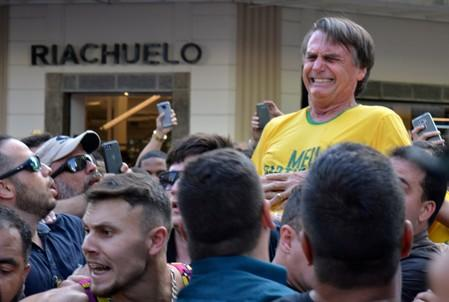 FILE PHOTO: Brazilian presidential candidate Jair Bolsonaro reacts after being stabbed during a rally