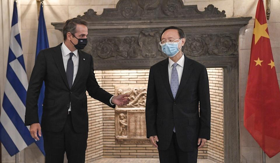 Greek Prime minister Kyriakos Mitsotakis and welcomes director of the Central Foreign Affairs Commission of the Chinese Communist Party Yang Jiechi (R) during their meeting in Athens, Greece, 04 September 2020. Photo: EPA-EFE