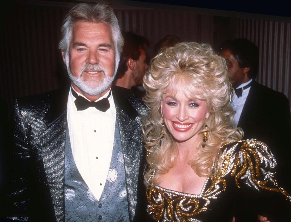 Country music legend Kenny Rogers, who sold more than 100 million records in a career that spanned decades and seen here with his frequent duet partner Dolly Parton, died on March 20, 2020 at 81.