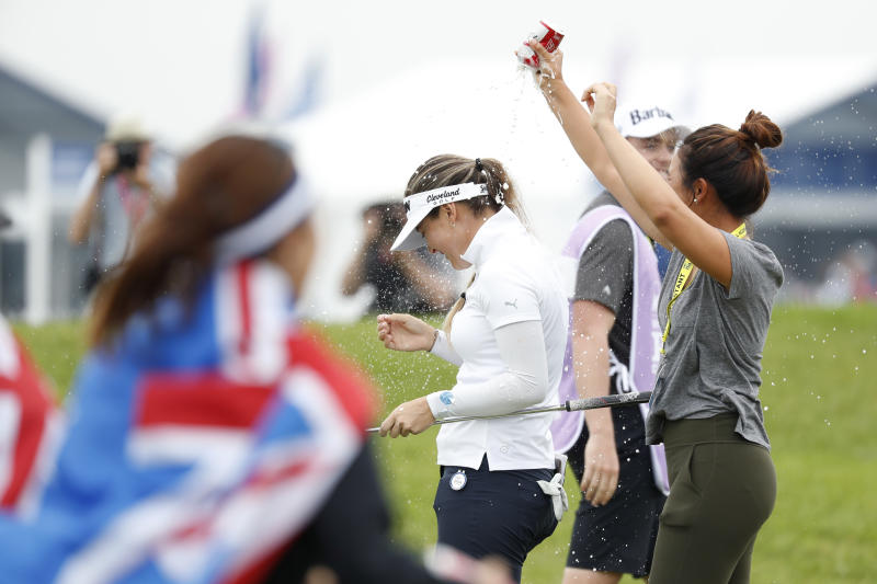 Hannah Green, center, of Australia, celebrates with fans after winning the KPMG Women's PGA Championship golf tournament, Sunday, June 23, 2019, in Chaska, Minn. (AP Photo/Charlie Neibergall)