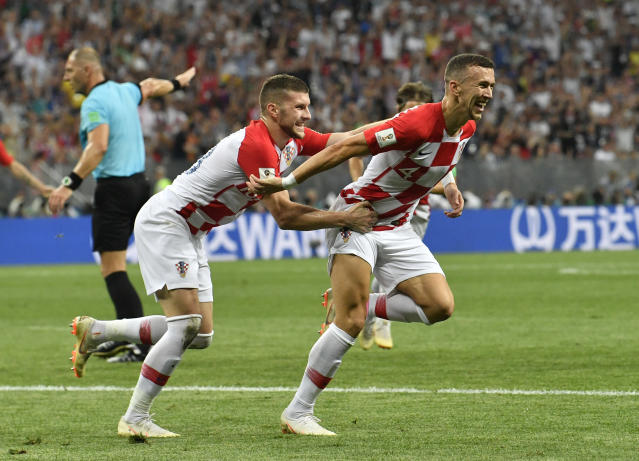 Croatia's Ivan Perisic, right, celebrates after scoring his side's opening goal during the final match between France and Croatia at the 2018 soccer World Cup in the Luzhniki Stadium in Moscow, Russia, Sunday, July 15, 2018. (AP Photo/Martin Meissner)