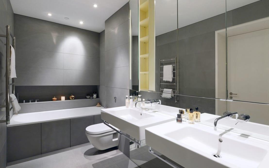 <p>Your perfume and cologne bottles might be gorgeous, but the fluctuations on temperature in a bathroom can affect the contents of them! Scents that are exposed to constant heat and cold will naturally deteriorate a lot more quickly than those kept at a steady room temperature, so get them out!</p>  Credits: homify / Graham D Holland