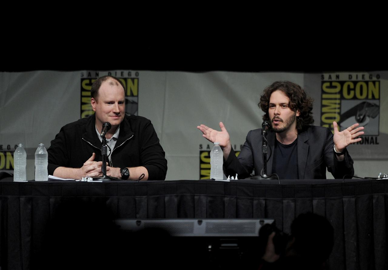 "SAN DIEGO, CA - JULY 14:  Producer Kevin Feige (L) and writer Steven Wright speak at Marvel Studios ""Iron Man 3"" panel during Comic-Con International 2012 at San Diego Convention Center on July 14, 2012 in San Diego, California.  (Photo by Kevin Winter/Getty Images)"
