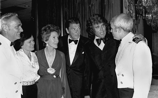<p>Former California Governor Ronald Reagan, center, actor Michael Landon, second from right, and the governor's wife Nancy, third from left, greet former POWs during a reunion party in Los Angeles May 28 1978. At left, U.S. Navy Capt. Howard Ruttledge and his wife, Phyllis. At right is U.S. Navy Commander John McCain. (Photo: Brich/AP) </p>