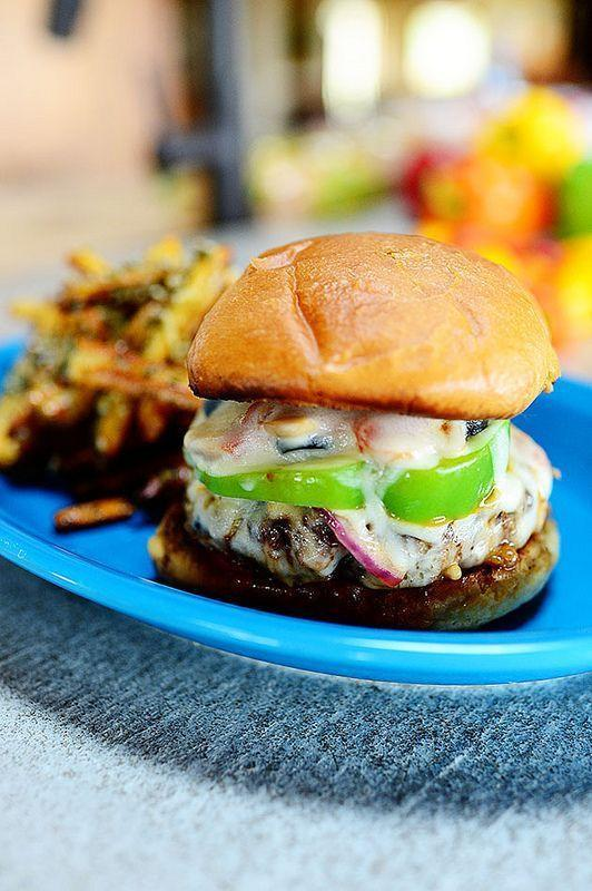 """<p>A combination of sausage, ground beef, and Italian seasoning makes these pizza-inspired burgers extra flavorful. But it's the toppings that really make them supreme: cheese, veggies, olives, marinara sauce, and pepperoni! </p><p><a href=""""https://www.thepioneerwoman.com/food-cooking/recipes/a11757/supreme-pizza-burgers/"""" rel=""""nofollow noopener"""" target=""""_blank"""" data-ylk=""""slk:Get Ree's recipe."""" class=""""link rapid-noclick-resp""""><strong>Get Ree's recipe. </strong></a></p><p><a class=""""link rapid-noclick-resp"""" href=""""https://go.redirectingat.com?id=74968X1596630&url=https%3A%2F%2Fwww.walmart.com%2Fsearch%2F%3Fquery%3Dpioneer%2Bwoman%2Bcooking%2Butensils&sref=https%3A%2F%2Fwww.thepioneerwoman.com%2Ffood-cooking%2Fmeals-menus%2Fg37078352%2Fitalian-sausage-recipes%2F"""" rel=""""nofollow noopener"""" target=""""_blank"""" data-ylk=""""slk:SHOP COOKING UTENSILS"""">SHOP COOKING UTENSILS</a></p>"""