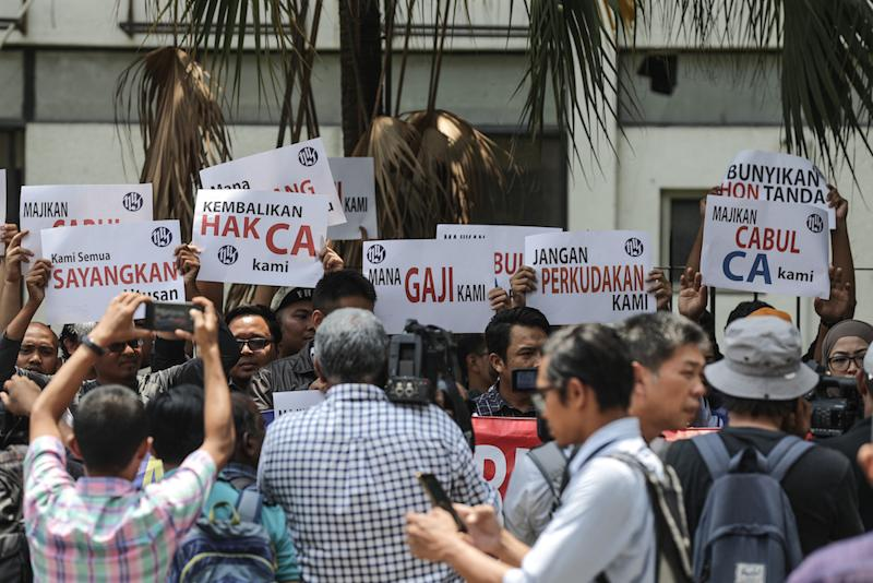 Utusan Malaysia workers protest over unpaid salaries in front of Utusan headquarters in Kuala Lumpur August 19, 2019. — Picture by Ahmad Zamzahuri