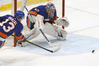 New York Islanders center Mathew Barzal (13) and goaltender Semyon Varlamov (40) defend against the Washington Capitals during the first period of an NHL hockey Thursday, April 22, 2021, in Uniondale, N.Y. (AP Photo/Kathy Willens)