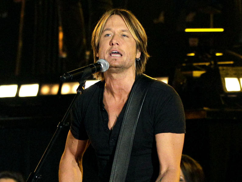 FILE - In this Nov. 9, 2011 file photo, singer Keith Urban performs during the 45th Annual CMA Awards in Nashville, Tenn. Urban emerged from his surgery to remove a polyp and a nodule from his vocal cords with benefits he never imagined. (AP Photo/Mark Humphrey, file)
