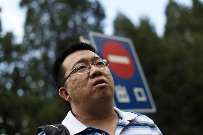 "Steve Wang, one of the relatives of Chinese passengers onboard the missing Malaysia Airlines Flight 370, speaks to journalists near a ""No Entry"" sign outside a hotel in Beijing, China, Friday, May 2, 2014. Senior officials from Malaysia, Australia and China will meet early next week to decide on the next step in the search for the Malaysia Airlines jet, while expressing confidence Friday that the hunt was on the right track despite no wreckage being found so far. (AP Photo/Alexander F. Yuan)"