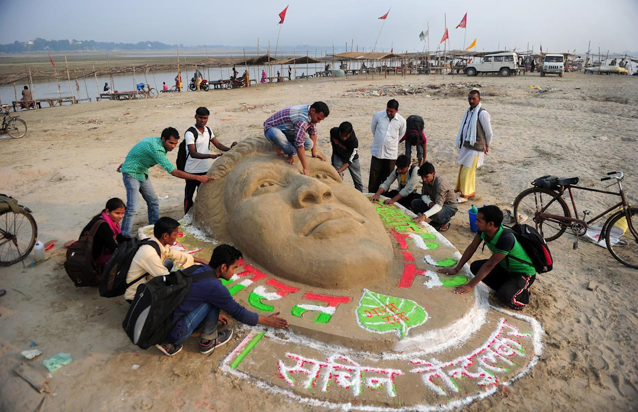 Indian students of Allahabad University and cricket fans make a sand sculpture of Indian cricketer Sachin Tendulkar at Sangam in Allahabad on November 14, 2013.    Delirious crowds greeted India's Sachin Tendulkar as he walked out to bat in his last Test match on November 14, 2013 as the 40-year-old is ending an international career during which he became the all-time leading Test and one-day batsman and the only man to score 100 international centuries. AFP PHOTO/SANJAY KANOJIA        (Photo credit should read Sanjay Kanojia/AFP/Getty Images)