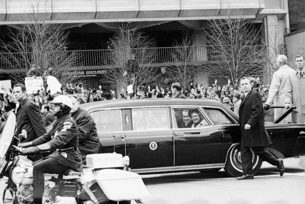 PHOTO: President Richard Nixon and First Lady Pat Nixon in the presidential limousine, surrounded by secret service after taking the oath of office as the 37th President of the United States, Jan. 20, 1969. (Bettmann Archive/Getty Images)