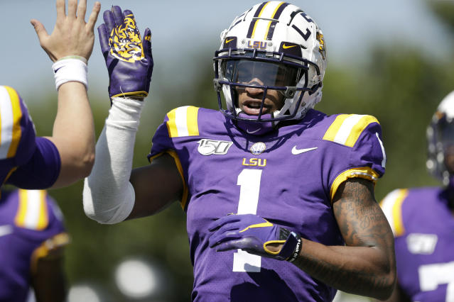 LSU wide receiver Ja'Marr Chase (1) is congratulated after scoring a touchdown on a 25-yard pass against Vanderbilt in the first half of an NCAA college football game Saturday, Sept. 21, 2019, in Nashville, Tenn. (AP Photo/Mark Humphrey)