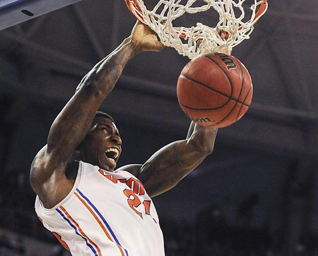 Florida forward Casey Prather (24) dumps the ball through the basket during the first half of an NCAA college basketball game against South Carolina, Wednesday, Jan. 8, 2014 in Gainesville, Fla. (AP Photo/Phil Sandlin)