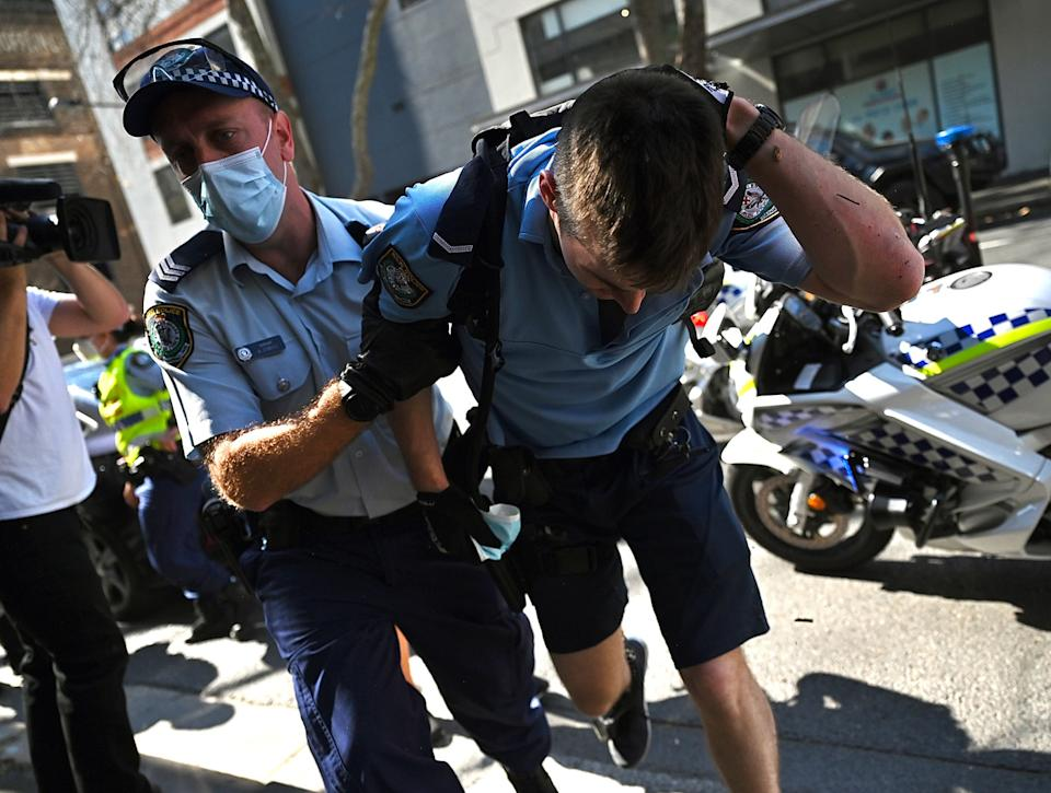 A police officer was injured during a anti-lockdown protest in Sydney on Saturday. Source: AAP