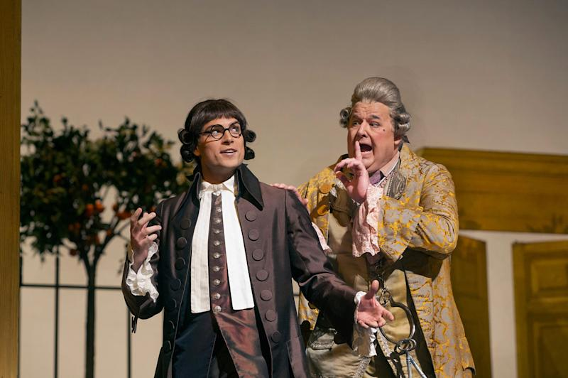 "In this Dec. 14, 2012 publicity photo, Alek Shrader as Count Almaviva (in disguise as Don Alonso) and John Del Carlo as Dr. Bartolo are seen in Rossini's ""The Barber of Seville,"" during rehearsal at the Metropolitan Opera in New York. (AP Photo/Metropolitan Opera, Ken Howard)"