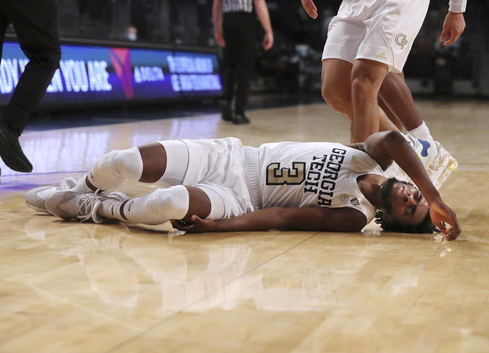 Georgia Tech guard Bubba Parham lies on the court briefly after falling during the team's 57-49 loss to Virginia in an NCAA college basketball game Wednesday, Feb. 10, 2021, in Atlanta. (Curtis Compton/Atlanta Journal-Constitution via AP)