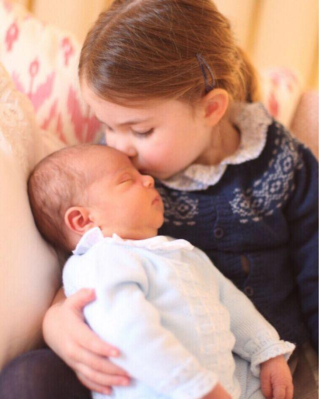 "<p>The family shared another picture from the same series, this time with Prince Louis being <a href=""https://www.cosmopolitan.com/uk/reports/a20658303/princess-charlotte-prince-louis-baby-big-sister-bond/"" rel=""nofollow noopener"" target=""_blank"" data-ylk=""slk:held and kissed by his doting older sister"" class=""link rapid-noclick-resp"">held and kissed by his doting older sister</a>, Princess Charlotte.</p><p><a href=""https://www.instagram.com/p/BiadXx_g4z0/"" rel=""nofollow noopener"" target=""_blank"" data-ylk=""slk:See the original post on Instagram"" class=""link rapid-noclick-resp"">See the original post on Instagram</a></p>"