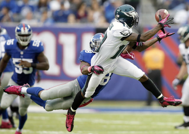 Philadelphia Eagles' DeSean Jackson (10) attempts to catch a pass as New York Giants' Trumaine McBride (38) defends against him during the second half of an NFL football game on Sunday, Oct. 6, 2013, in East Rutherford, N.J. The pass was incomplete. (AP Photo/Kathy Willens)