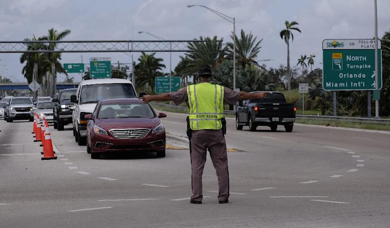 A law enforcement officer directs traffic at a checkpoint preventing residents of the Florida Keys from returning to their homes following Hurricane Irma