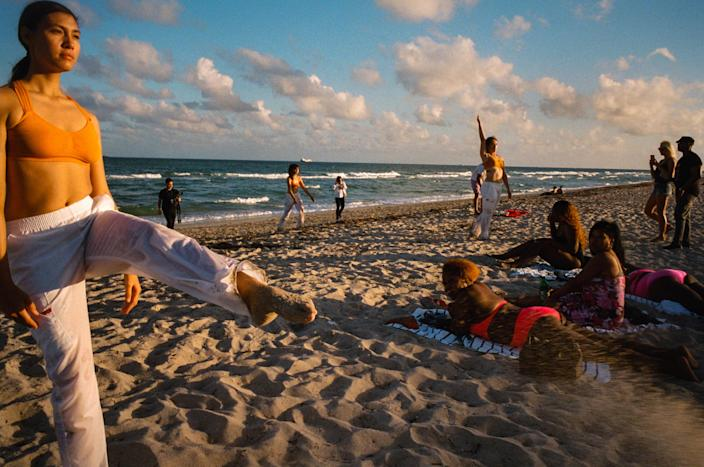 Beachgoers in Miami, December 2017. (Daniel Arnold/The New York Times)