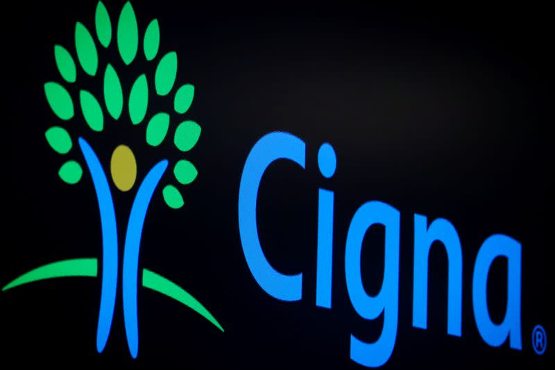 A screen displays the logo fro Cigna Corp. on the floor at the NYSE in New York