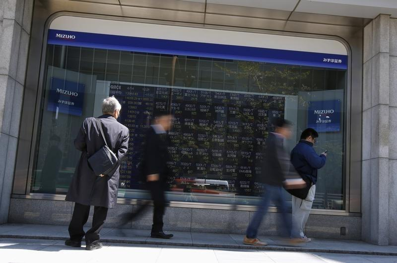 A man looks at a stock quotation board outside a brokerage in Tokyo
