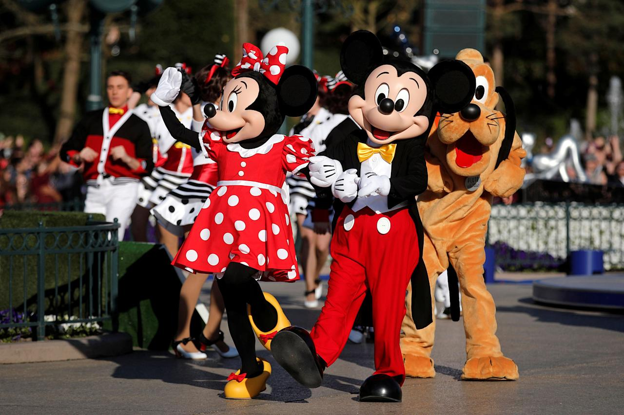 <p>Disney characters Mickey Mouse and Minnie Mouse attend the 25th anniversary of Disneyland Paris at the park in Marne-la-Vallee, near Paris, France, April 12, 2017. (Benoit Tessier/Reuters) </p>