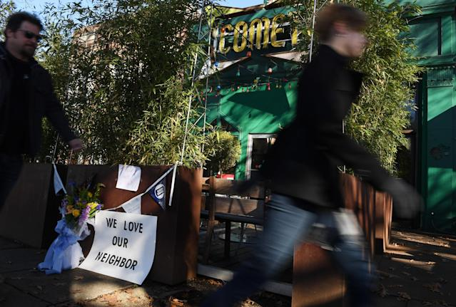 People pass Comet Ping Pong on Dec. 5, 2016, in Washington, D.C. A man identified as Edgar Maddison Welch was arrested Dec. 4, 2016, after coming to the restaurant armed. The incident was linked to a series of fake news stories that have been dubbed Pizzagate. (Photo: Matt McClain/The Washington Post via Getty Images)