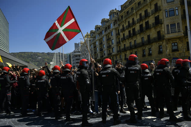 Basques pro-independence supporters hold Ikurrina (Basque flags and Catalonia independence flag known as ''estelada'') flags as they clash with riot police.