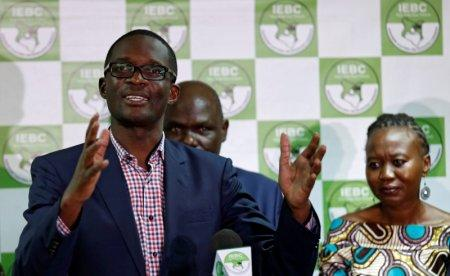 FILE PHOTO: Chief Electoral Officer of Kenya's Independent Electoral and Boundaries Commission (IEBC) Ezra Chiloba, flanked by chairman Wafula Chebukati and commissioner Roselyn Akombe, addresses a news conference at their offices in Nairobi, Kenya, July 6, 2017. REUTERS/Thomas Mukoya