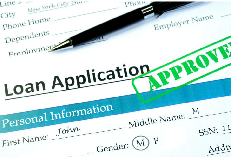 Loan application with approved stamp on it.
