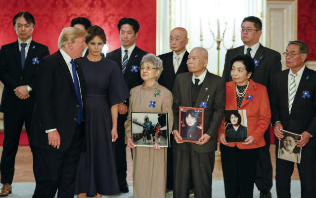 <p>President Donald Trump and First Lady Melania meets families of abductees by North Korea in Tokyo on Nov. 6, 2017.Trump met Sakie Yokota (front row C), 81, mother of Megumi Yokota who was abducted by North Korean agents in Japan when she was a 13-year-old junior high school student, and Megumi's twin brothers Takuya and Tetsuya Yokota (Left behind of Sakie). (Photo: Kimimasa Mayama/AFP/Getty Images) </p>
