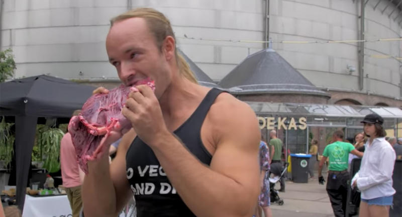 The pro-meat protester was filmed eating a hunk of raw meat at a vegan festival in Amsterdam, to wind up attendees