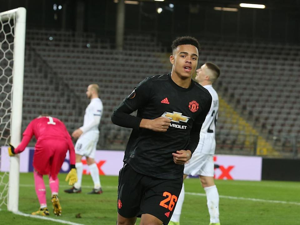 Mason Greenwood celebrates scoring for Manchester United against LASK: Manchester United via Getty Images