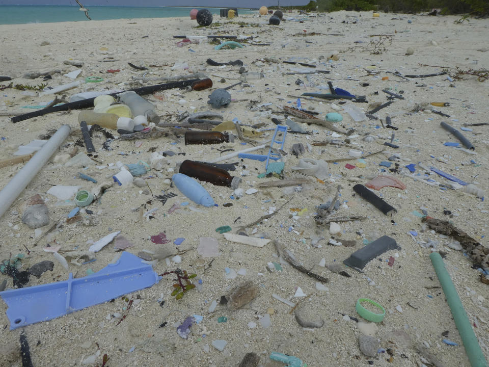 In this April 9, 2021 photo provided by Matt Saunter, marine debris including plastic covers the beach on Midway Atoll in the Northwestern Hawaiian Islands. A crew has returned from the remote Northwestern Hawaiian Islands with a boatload of marine plastic and abandoned fishing nets that threaten to entangle endangered Hawaiian monk seals and other marine animals on the tiny, uninhabited beaches stretching for more than 1,300 miles north of Honolulu. (Matt Saunter, Papahanaumokuakea Marine Debris Project via AP)