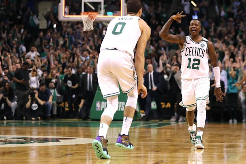 Terry Rozier of the Boston Celtics celebrates with Jayson Tatum after  hitting a three point shot 406b2a1e2