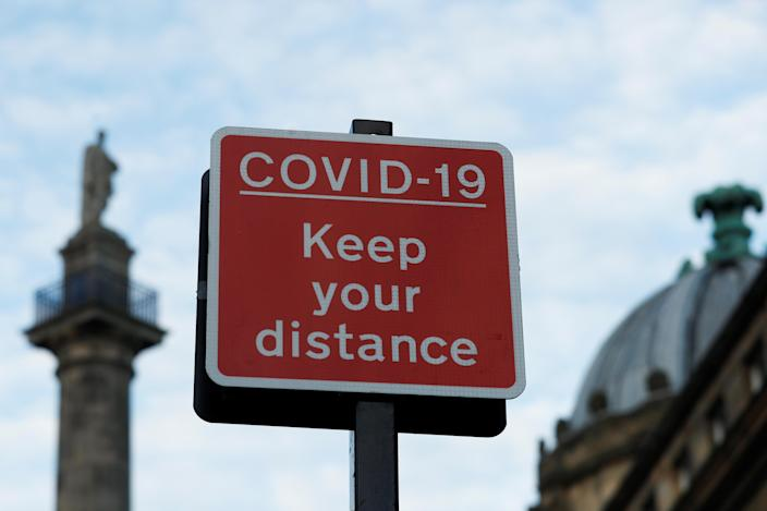 A sign is pictured amid the coronavirus disease (COVID-19) outbreak, in Newcastle, Britain October 10, 2020. REUTERS/Lee Smith