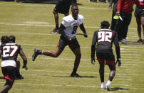 Atlanta Falcons' Kyle Pitts, center, runs drills during an NFL football rookie minicamp on Friday, May 14, 2021, in Flowery Branch, Ga. (AP Photo/Brynn Anderson)