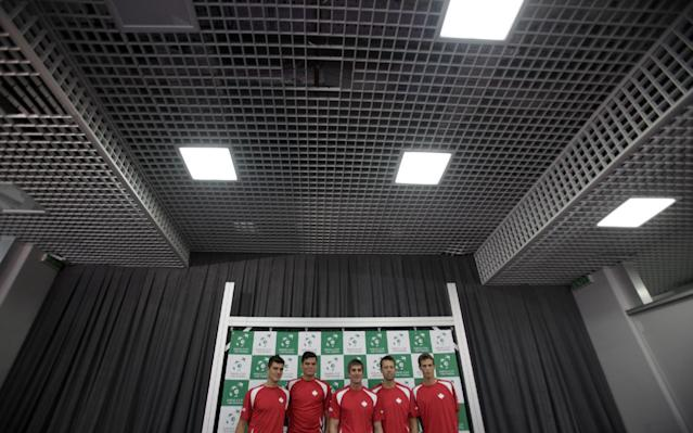 Canada Davis Cup team members, from left, Frank Dancevic, Milos Raonic, team captain Martin Laurendeau, Daniel Nestor, and Vasek Pospisil pose after a press conference in Belgrade, Serbia, Wednesday, Sept. 11, 2013. Canada will play Serbia in the Davis Cup semifinal starting on Sept. 13 in Belgrade. (AP Photo/Darko Vojinovic)