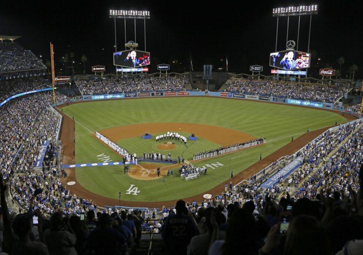 Vin scully is honored in a ceremony before a baseball game against the