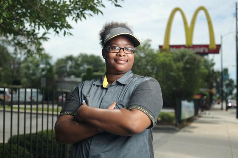 McDonald's employee Ashley Bruce poses in front of the restaurant where she works in Chicago