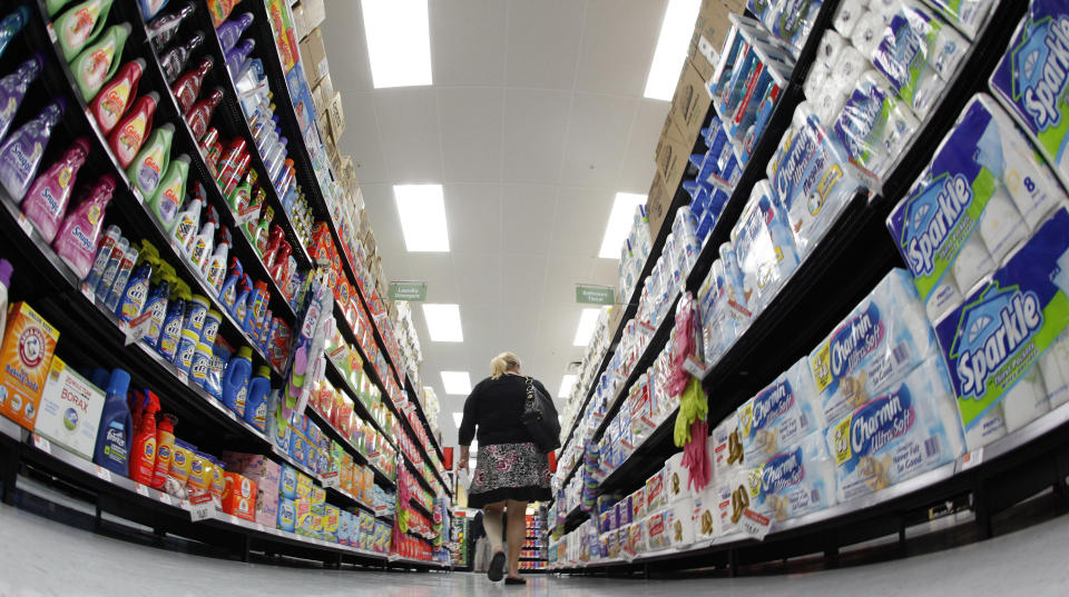A shopper walks down an aisle in a newly opened Walmart Neighborhood Market in Chicago September 21, 2011. The 27,000 square foot (2508 square meters) store is the first in Illinois with an emphasis on groceries and basic household goods.  REUTERS/Jim Young      (UNITED STATES - Tags: FOOD BUSINESS)