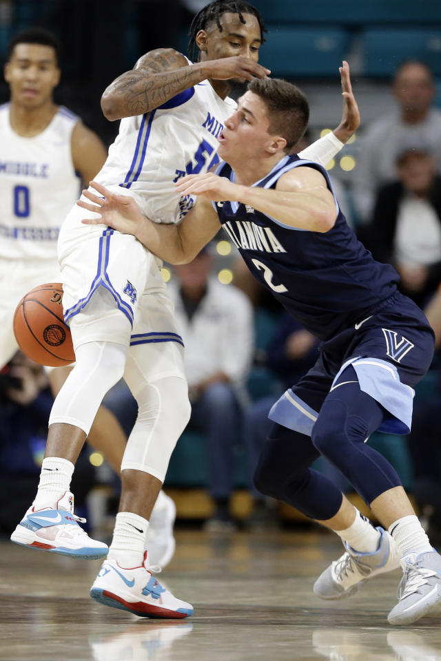 Middle Tennessee State guard Antonio Green (55) and Villanova guard Collin Gillespie (2) struggle for possession of the ball during the first half of an NCAA college basketball game at the Myrtle Beach Invitational in Conway, S.C., Thursday, Nov. 21, 2019. (AP Photo/Gerry Broome)