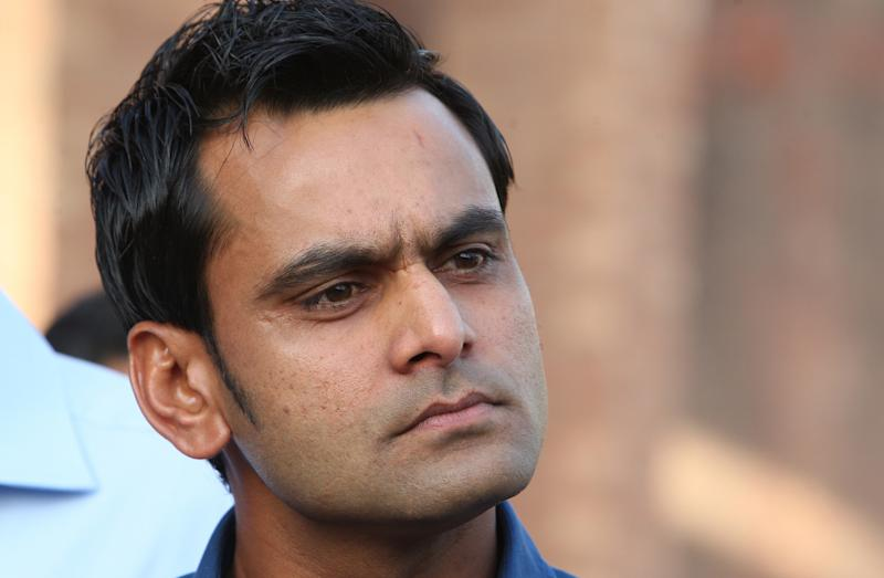 Pakistan's cricket player Mohammad Hafeez listens to reporters during a news conference in Lahore, Pakistan, Thursday, April 3, 2014. Hafeez quit as captain of Pakistan's Twenty20 team on Thursday after it failed to qualify for the semifinals of the World Twenty20 in Bangladesh. (AP Photo/K.M. Chaudary)