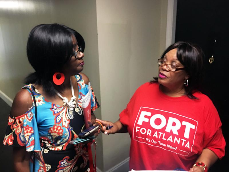 Deborah Arnold (right), a Fort campaign volunteer, speaks with Shelby Porter while canvassing the mixed-income City Views high-rise.