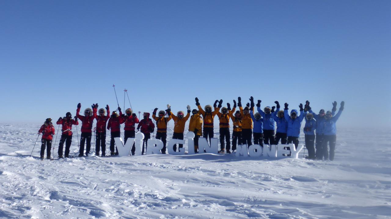 Teams pose for a picture on the first day of the Virgin Money South Pole Allied Challenge 2013 expedition in Antarctica December 1, 2013. Prince Harry set off on Sunday on his 300 kilometre (186 miles) walk to the South Pole for the charity Walking With The Wounded (WWTW) to raise money for wounded servicemen and women. The Virgin Money South Pole Allied Challenge 2013, of which Harry is patron, will see the participants race across three degrees to the South Pole. All 12 injured service personnel from Britain, America, Canada and Australia have overcome life-changing injuries and undertaken challenging training programmes to prepare themselves for the conditions they will face in Antarctica. Trekking around up to 20km (12 miles) per day, the teams will endure temperatures as low as minus 45 centigrades (minus 113 Fahrenheit) and 80 kph (50 mph) winds as they pull their 70 kg (154 pound) sleds, known as pulks, towards the southernmost point on the globe. Picture taken December 1, 2013. REUTERS/Victoria Nicholson/Walking With the Wounded (ANTARCTICA - Tags: ENVIRONMENT ROYALS SPORT MILITARY) NO COMMERCIAL OR BOOK SALES. NO SALES. FOR EDITORIAL USE ONLY. NOT FOR SALE FOR MARKETING OR ADVERTISING CAMPAIGNS. MANDATORY CREDIT