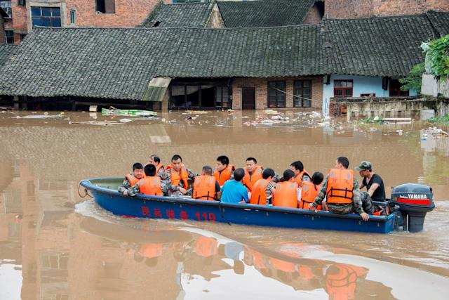<p>Rescuers evacuate people by boat during a flood in Xinshao county, Hunan province, China, July 2, 2017. (Photo: Stringer/Reuters) </p>